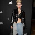Miley Cyrus parties in half-jeans-half-joggers
