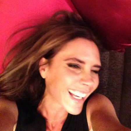 Victoria Beckham smiling in China