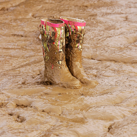 Wellies in mud at a festival