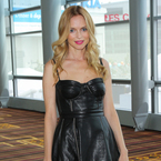 Heather Graham flashes pins in flirty leather dress