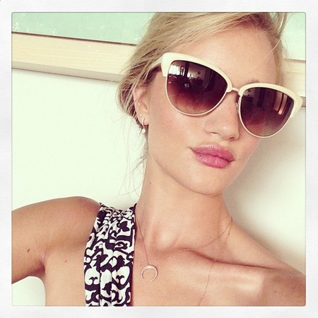 Rosie Huntington-Whiteley wears white sunglasses