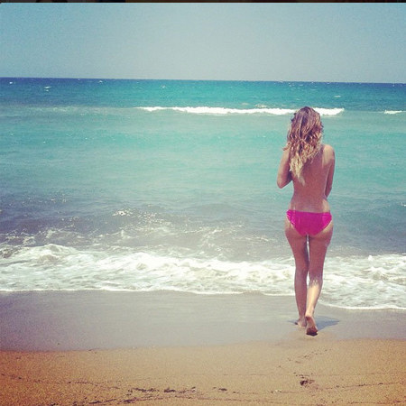 Made In Chelsea star Lucy Watson walks along the beach topless on holiday