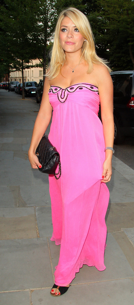 Holly Willoughby attends ITV summer party in bright pink maxi dress