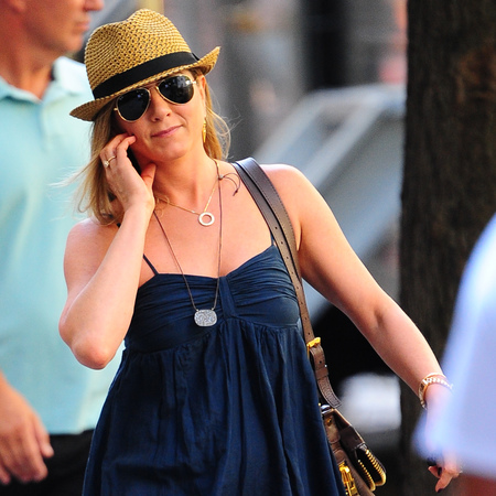 Jennifer Aniston shoots Squirrels to the Nuts in short sundress