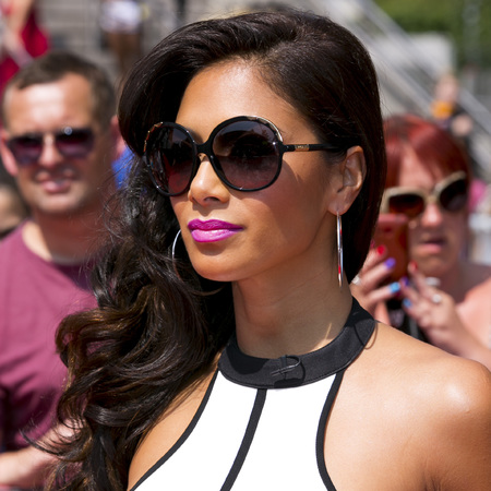 Nicole Scherzinger stuns with glossy curls and pink X Factor pout