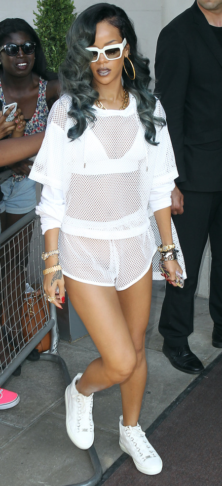 Rihanna wears sheer string vest and shorts