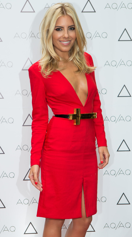 Mollie King in a low cut dress