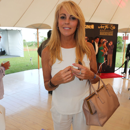 Dina Lohan with Prada handbag at charity event