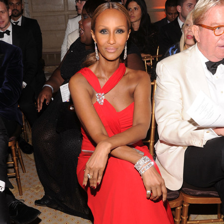 Iman in red dress at 4th Annual amfAR Inspiration Gala New York