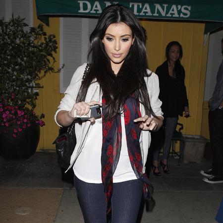 Kim Kardashian wearing Alexander McQueen skull scarf