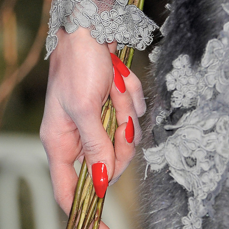Bright red talons at Thom Browne