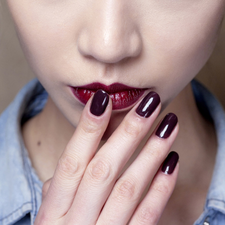 Glossy mulberry nails at Zac Posen