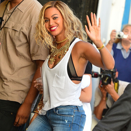 Beyonce in white vest, black bra, jeans and boots at Coney Island in New York