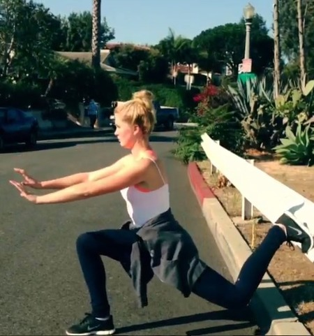 Ireland Baldwin and her roadside workout