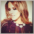 Caroline Flack shows off bronze smoky eye makeup