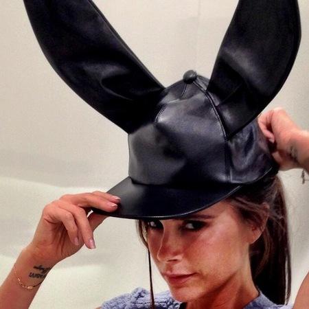 Victoria Beckham shows of Comme de Garçons hat