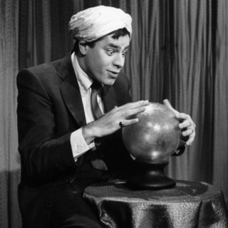 Jerry Lewis looking into crystal ball