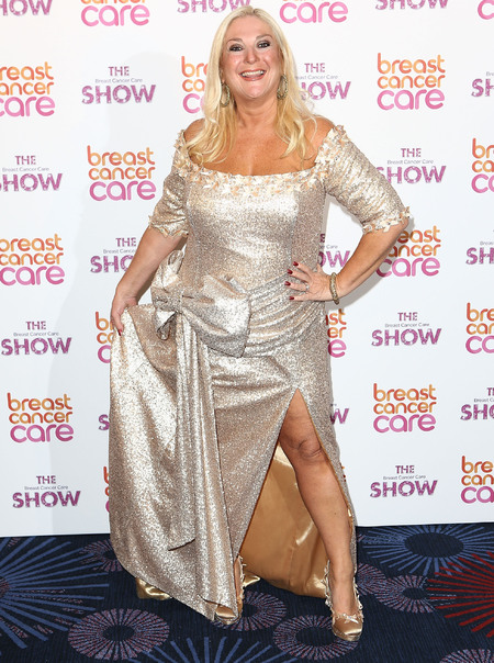 Vanessa Feltz in gold dress at Breast Cancer Care fashion show
