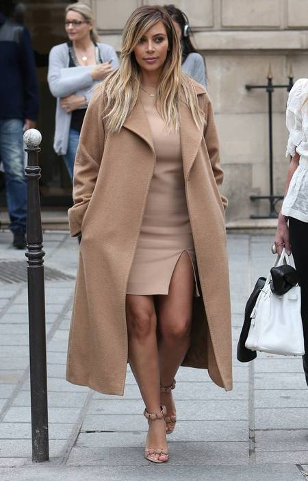 Kim Kardashian in camel coat from Max Mara at Paris Fashion Week