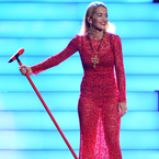 Rita Ora's red lace dress at Stephen Lawrence gig