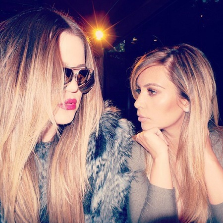 Kim Kardashian - Khloe Kardashian - matching blonde hair - reunited after argument over Lamar Odom divorce - handbag.com