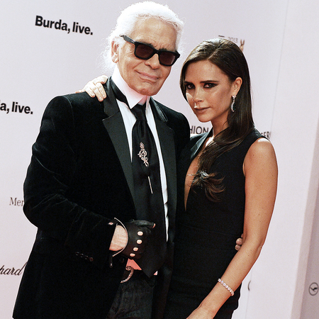 karl lagerfeld and victoria beckham - bambi awards 2013 - red carpet hug - november 2013 - handbag.com