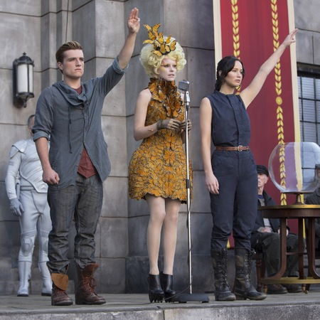 peeta, effie and katniss - hunger games catching fire - tour - alexander mcqueen dress