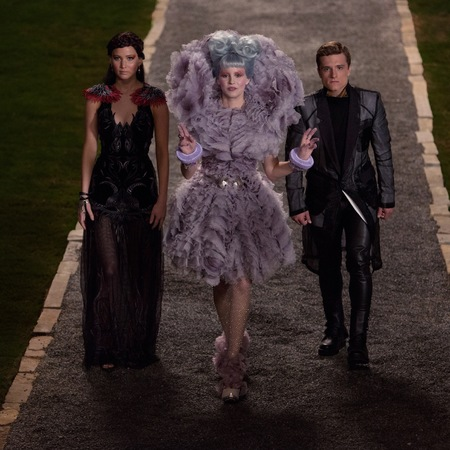 peeta, effie and katniss - hunger games cathcing fire - captial party - handbag.com