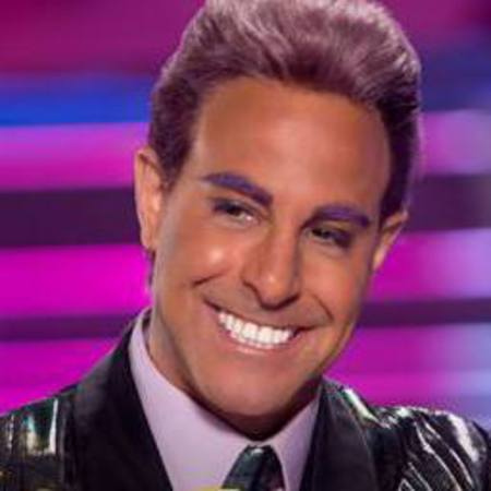 stanley tucci - caeser - purple eyebrows - hunger games catching fire - handbag.com