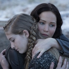 katniss and prim - hunger games catching fire - braids - hair - hug