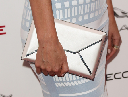 Miranda Kerr - jaguar motor show - smythson envelope clutch - close up - handbag.com
