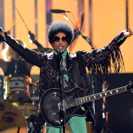 Prince performing at 2013 Billboard Music Awards - Prince fashion and style - handbag.com