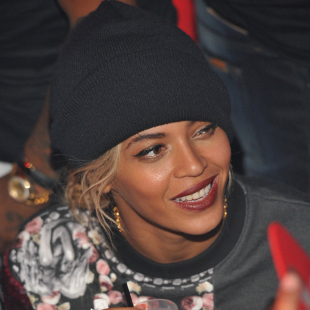 beyonce wearing a beanie hat - image makeover - orange nails - handbag.com