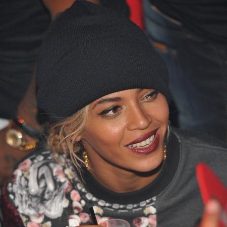 beyonce wearing a beanie hat - image makeover - orange nails - handbag.com