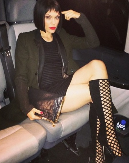 Jessie J's black shimmery Stella McCartney clutch