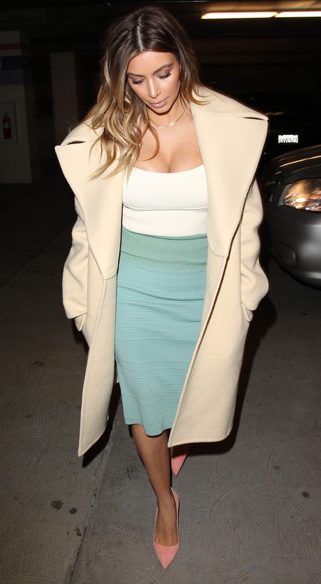 kim kardashian green pencil skirt and crop top - pastel coloured coat - how to wear a coat like celebrity - handbag.com
