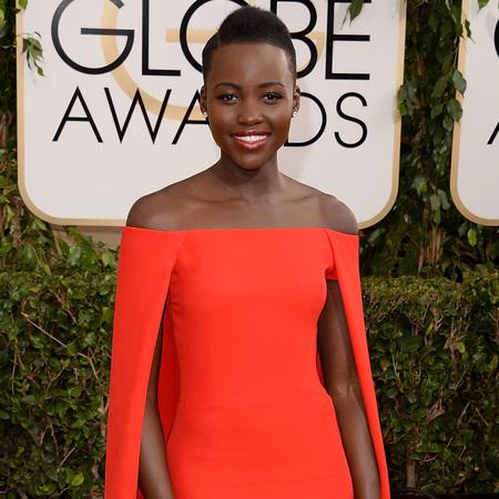 12 years a slave actress Lupita Nyongo red dress at golden globes 2014 - red dress trend - celebrity awards season dresses - handbag.com