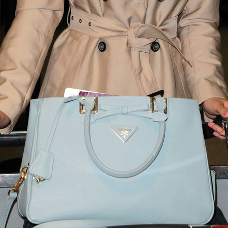 Amy Willerton - blue prada handbag - airport - mac - handbag.com