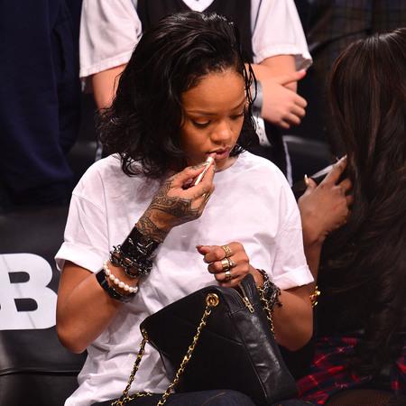 Rihanna - chanel handbag - close up - basket ball game - new york - white tshirt - handbag.com