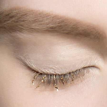 gold eye lashes at dries van noten ss14 fashion week show - glitter makeup trend - handbag.com