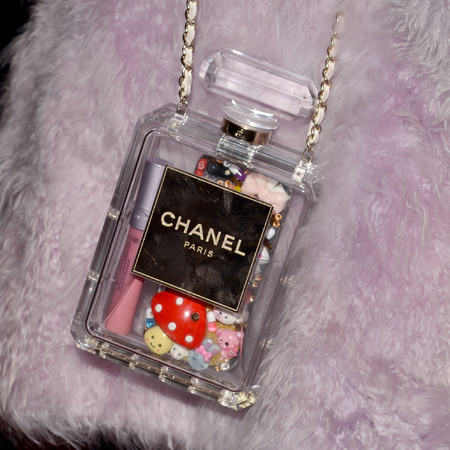 Miley Cyrus Chanel perfume bottle handbag - Pre Grammys gala in Los Angeles - handbag.com