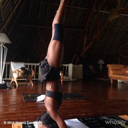 Naomi Campbell shows how to do a yoga headstand