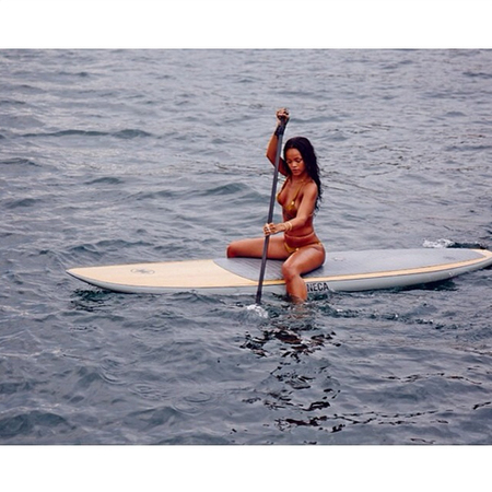 Rihanna - paddle boarding - in brazil - fitness - holiday exercise - handbag.com