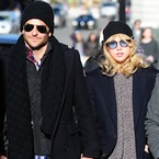 Bradley Cooper & Suki Waterhouse do matching hat PDA