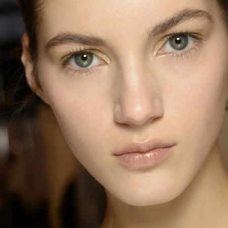 autumn winter 2014 makeup trends - gold glitter eye shadow - new york fashion week - handbag.com