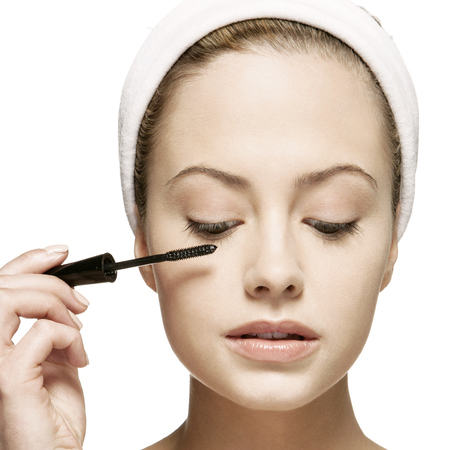 woman applying makeup - applying mascara - beauty and makeup routine - handbag.com