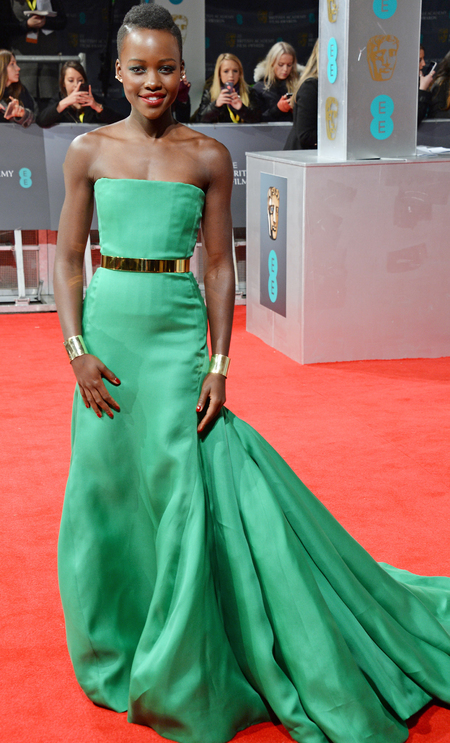 lupita nyongo at 2014 bafta awards - green dress - blue and green eye makeup - celebrity trends - handbag.com