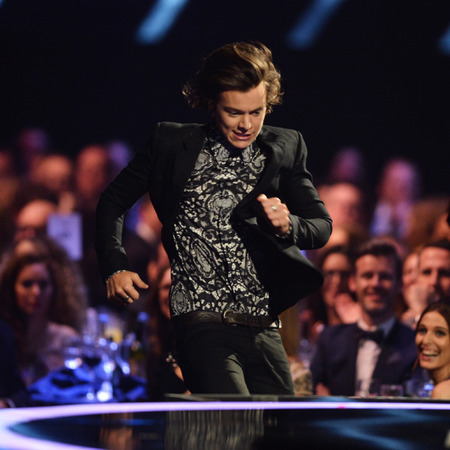 Harry Styles - the brits 2014 - brit awards - running - missed award - handbag.com