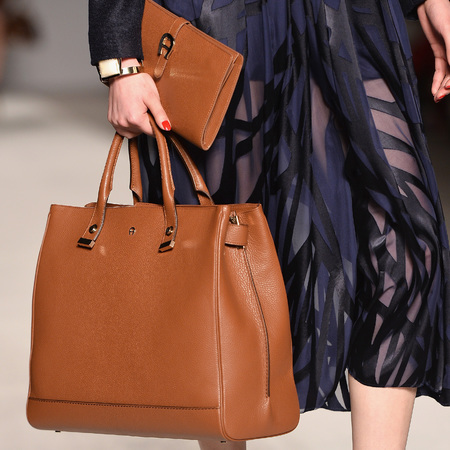 carrying two handbags trend - tan clutch and shoulder bag from aigner milna fashion week - autumn winter 2014 handbag trends - handbag.com