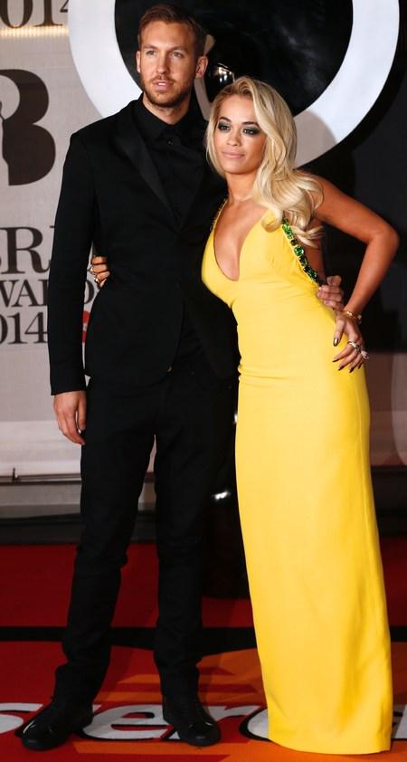 rita ora yellow dress - calvin harris - brits 2014 red carpet - smoky eyes makeup trend - handbag.com